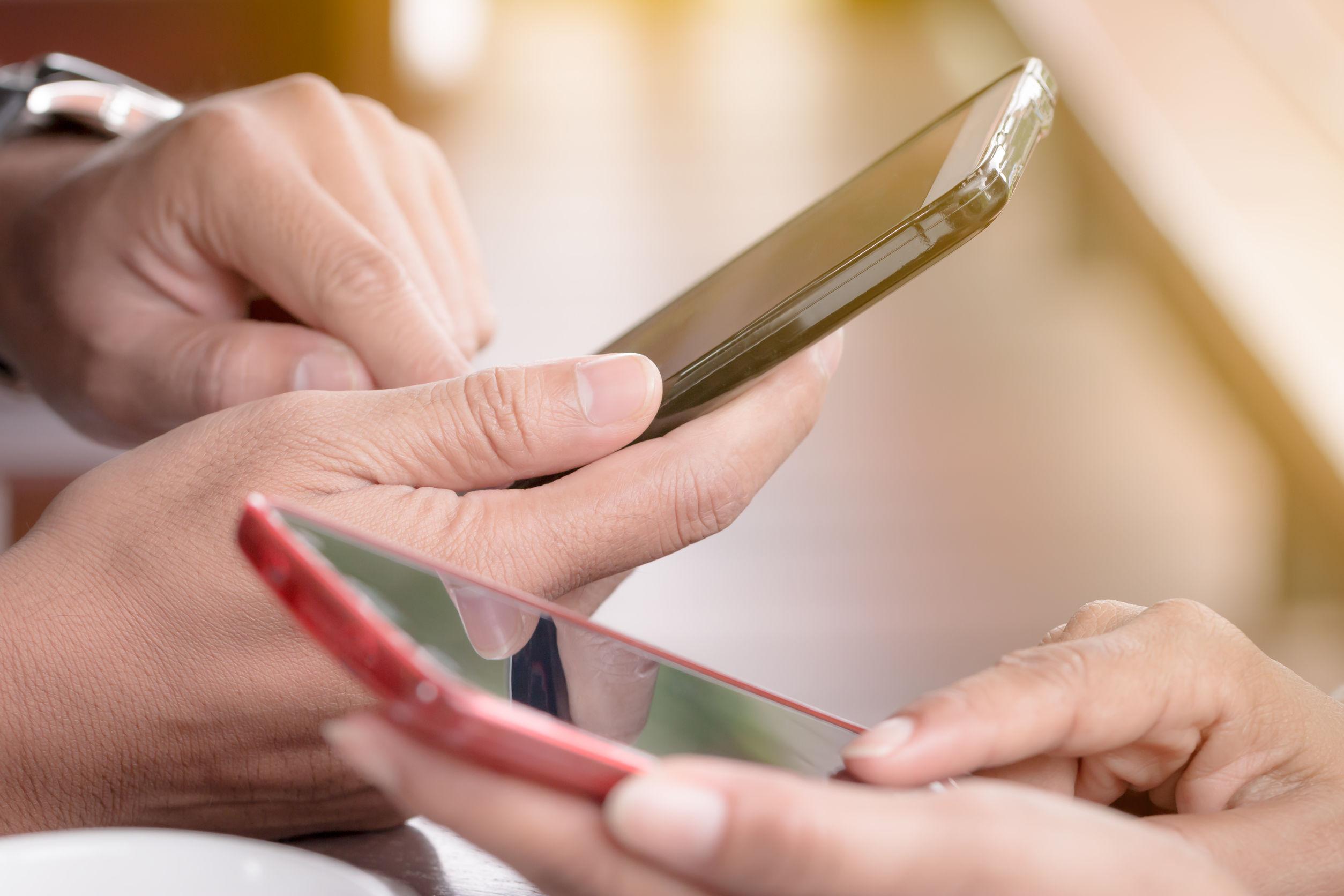 Two phones being used.jpg